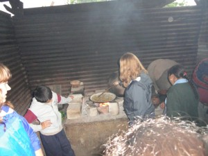 Operation Groundswell backpacker, Sarah, roasts coffee beans on the comal in Guatemala