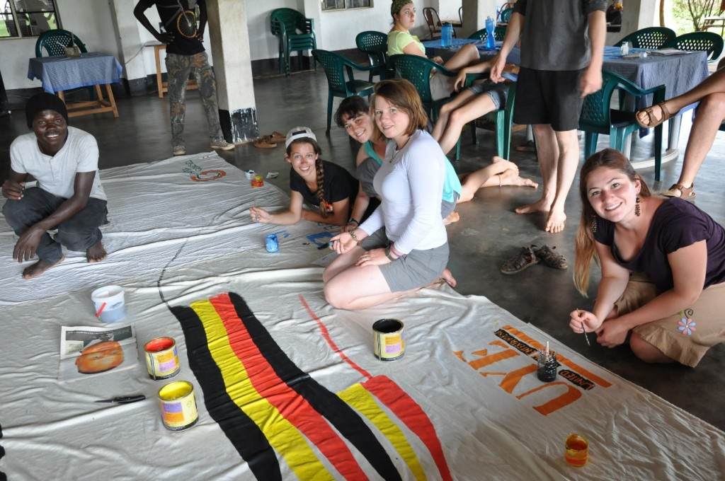 Members Andree, Cat, Sarah and Kyla work with UYE to design the backdrop for the night