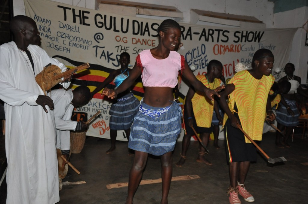 The Gulu Theatre Artists performing a traditional Acholi dance, Larakaraka