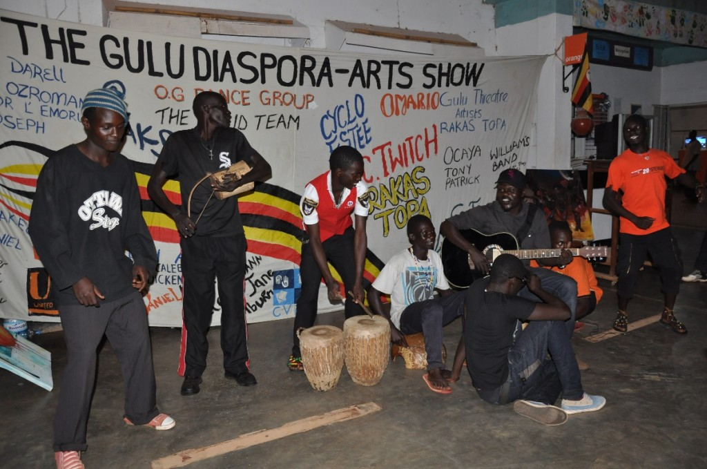 Local singer-songwriter Jeff Korondo with members of the Gulu Theatre Artists