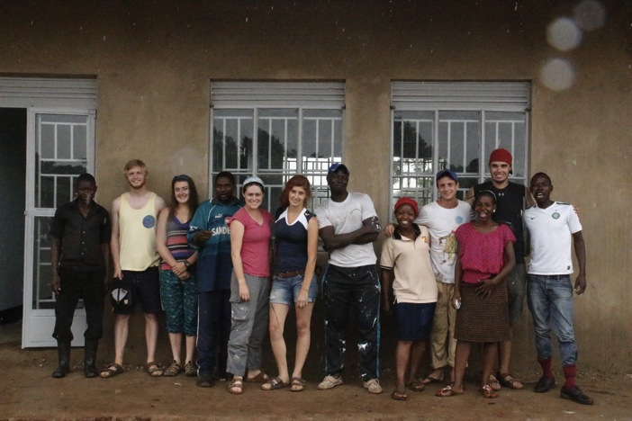 The team outside the newly-painted dormitories at the Ewafe Project.