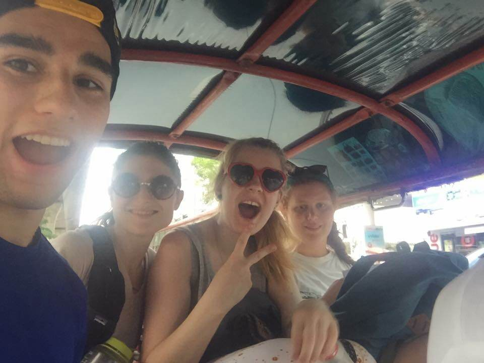 Hopping on one of our first tuk tuk rides cruising around the chaos and complexity of Bangkok! Photo by Chris Tuharsky.